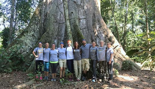 Photo of Dr. Karen Albaugh with physical therapy students and alumni near Peru's Tambopata River in the Amazon rain forest.