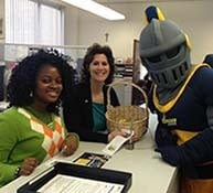 Two staff members with the NU Knight