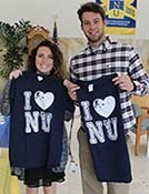 Two students showing off their I Heart NU tshirts