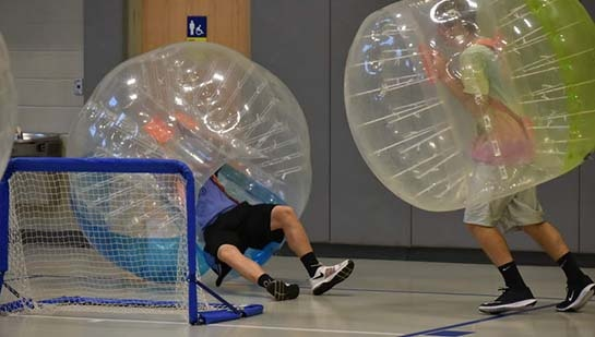 NU students playng bubble soccer