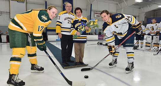 Photo of Tony & Dr. Rosalie Mirenda at the ceremonial puck drop for women's ice hockey