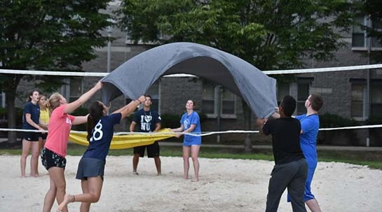 NU students playing water balloon volleyball