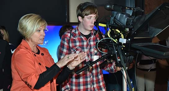 Photo of Andrew Walton of Great Valley High School getting tips about camera angles from NBC10's Karen Thomas