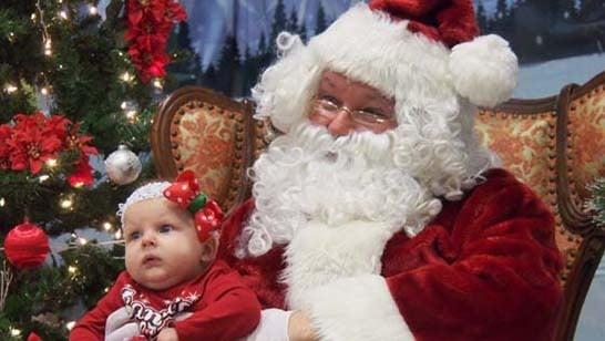 Photo of Santa holding a baby