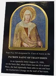 Photo of plaque depicting St. Clare of Assisi, the patron saint of television
