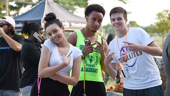 Welcome BBQ: Students posed at the campus picnic . . .