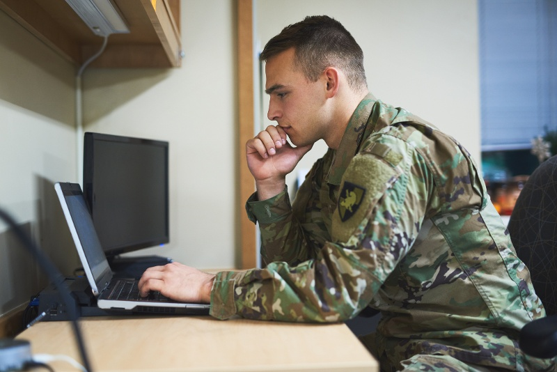 Military man working on a computer