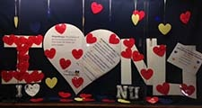 Photo of I Love NU display in library display case