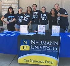 Photo of NU students manning The Neumann Fund table